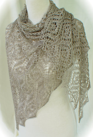 Ethereal Fichu is a sheer, flowing long triangular shoulder wrap knit in geometric lace motifs.