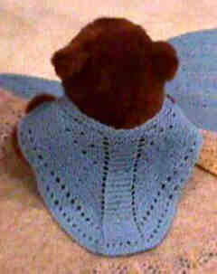 Doll-sized Faroese shawl on teddy bear