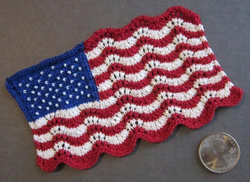 Mini Lace and Beaded Flag, a miniature knitted version of the American flag