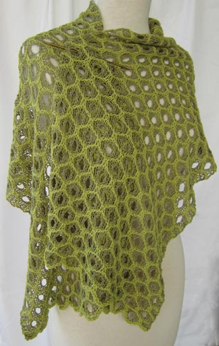 Honeycomb Lace Stole worn pinned at the shoulder with a short knitting needle