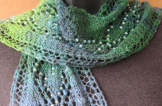 Spring Raindrops Lace Leaves Scarf. Sparkly beads glisten like raindrops, greeting the awakening of Spring's first leaves.