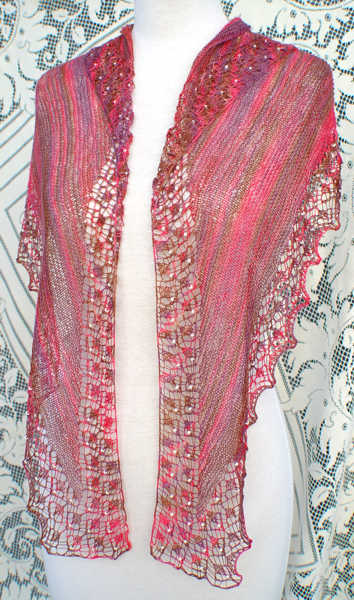Shallow Tri Shawl worn in traditional triangle shawl style with front tails left hanging